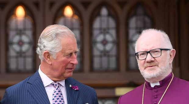 Church of Ireland Archbishop Richard Clarke, pictured with Prince Charles, has announced he will retire next February (Joe Giddens/PA)