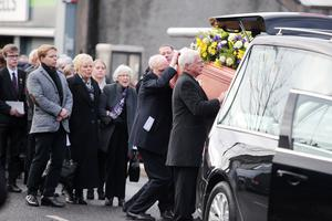 Press Eye - Belfast - Northern Ireland - 1st February 2018  Funeral service held for 64-year-old Robert Flowerday in Crumlin, Co. Antrim.  The retired teacher was found in his Crumlin home last week after being murdered during a burglary.  Mr Flowerday's coffin is carried by family and friends after the funeral service in Crumlin Presbyterian Church.   Picture by Jonathan Porter/PressEye