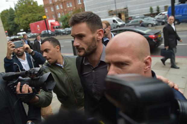 Lloris was met by scores of photographers and journalists as he arrived at court (Nick Ansell/PA)