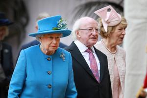 WINDSOR, ENGLAND - APRIL 08:  Queen Elizabeth II (L) walks with President of Ireland Michael D Higgins and Sabrina Higgins at Windsor Castle after a ceremonial welcome on April 8, 2014 in England. This is the first official visit by the head of state of the Irish Republic to the United Kingdom.  (Photo by Peter Macdiarmid/Getty Images)