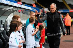 SWANSEA, WALES - OCTOBER 01:  Francesco Guidolin, Manager of Swansea City high fives the Swansea City mascots prior to kick off during the Premier League match between Swansea City and Liverpool at Liberty Stadium on October 1, 2016 in Swansea, Wales.  (Photo by Stu Forster/Getty Images)