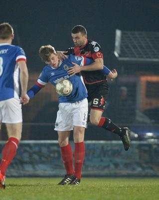 Presseye.com 7th February 2017 Toals County Antrim Shield final between Crusaders and Linfield at the Showgrounds in Ballymena. Crusaders Colin Coates  in action with Linfields Cameron Stewart Photograph by Presseye/Stephen Hamilton