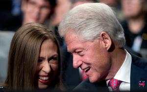 Former President Bill Clinton, right, speaks to his daughter Chelsea Clinton, left, before the third presidential debate at University of Nevada in Las Vegas, Wednesday, Oct. 19, 2016. (AP Photo/Andrew Harnik)