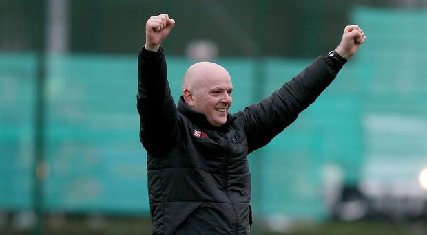 Queen's boss Peter Thompson celebrates his side's win over Linfield.