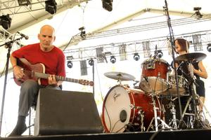 INDIO, CA - APRIL 13:  Musicians Ian MacKaye (L) and Amy Farina from the band The Evens perform onstage during day 2 of the 2013 Coachella Valley Music & Arts Festival at the Empire Polo Club on April 13, 2013 in Indio, California.  (Photo by Karl Walter/Getty Images for Coachella)