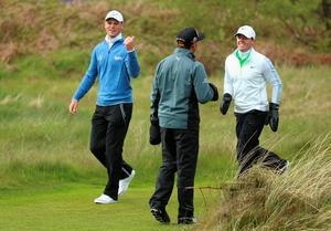 NEWCASTLE, NORTHERN IRELAND - MAY 29:  Martin Kaymer of Germany walks down the 15th hole with Rory McIlroy of Northern Ireland and Rickie Fowler of the United States during the Second Round of the Dubai Duty Free Irish Open Hosted by the Rory Foundation at Royal County Down Golf Club on May 29, 2015 in Newcastle, Northern Ireland.  (Photo by Andrew Redington/Getty Images)