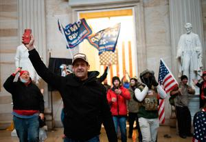 WASHINGTON, DC - JANUARY 06:  A pro-Trump mob enters the Roturnda of the U.S. Capitol Building on January 06, 2021 in Washington, DC. Congress held a joint session today to ratify President-elect Joe Biden's 306-232 Electoral College win over President Donald Trump. A group of Republican senators said they would reject the Electoral College votes of several states unless Congress appointed a commission to audit the election results. (Photo by Win McNamee/Getty Images)