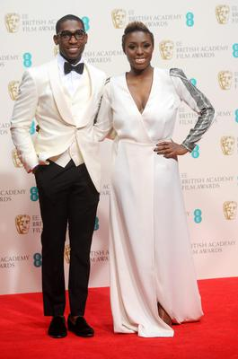 LONDON, ENGLAND - FEBRUARY 16:  Presenters Tinie Tempah and Laura Mvula pose in the winners room at the EE British Academy Film Awards 2014 at The Royal Opera House on February 16, 2014 in London, England.  (Photo by Anthony Harvey/Getty Images)