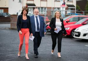Sinn Fein leader in Northern Ireland Michelle O'Neill (right) with Westminster candidate Francis Molloy (centre) and MLA Linda Dillon (left) at St Patrick's Primary School in Clonoe, Co Tyrone before casting their votes in the 2017 General Election. Liam McBurney/PA Wire