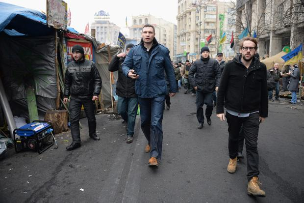 KIEV, UKRAINE - FEBRUARY 22:  Opposition leader Vitali Klitschko arrives to address anti-government demonstrators who remain in Independence square February 22, 2014 in Kiev, Ukraine. The offices of Ukrainian President Viktor Yanukovych have been left unguarded, with the protesters in full control of the streets surrounding the government district. The opposition have called for elections to take place on May 25 and demanded that President Yanukovych stand down immediately. (Photo by Jeff J Mitchell/Getty Images)