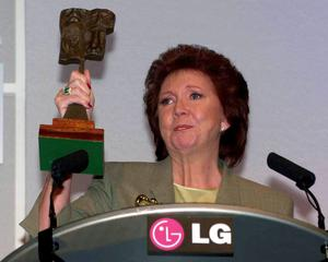 Cilla Black after she received a special award for outstanding contribution to broadcasting, at the Television and Radio Industries Club (Tric) Awards in London in 2000. Stefan Rousseau/PA Wire.