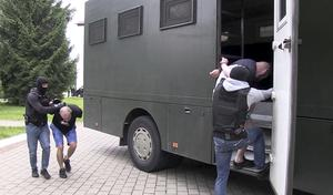 More than 30 detained employees of private Russian military contractor Wagner are facing a criminal probe (Belarusian KGB, State TV and Radio Company of Belarus via AP)