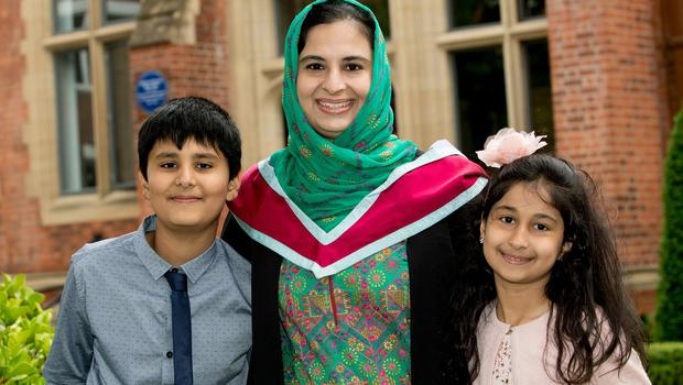 Celebrating graduation success is Asma Niazi, originally from Pakistan, who graduated with a masters from the School of Social Sciences, Education and Social Work from Queen's University Belfast. She is pictured with her children, Abu and Hanadil.