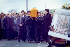 Dominic McGlincheys two sons Dominic Jnr (left) and Declan (right) carry their fathers coffin at his funeral in Bellaghy PACEMAKER BELFAST  Archive 13/2/1994