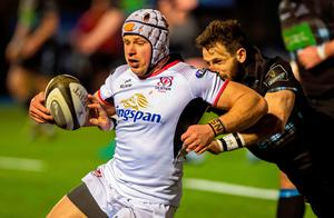 Gripping affair: Glasgow's Tommy Seymour knocks the ball out of the hand of Ulster's Luke Marshall
