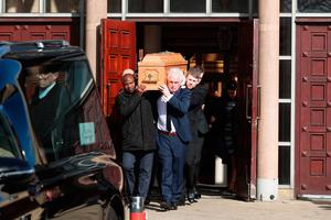 The coffin is carried from St Colmcille's Church, Holywood, Co Down at the funeral of boxing promoter and bookmaker Barney Eastwood. PA Photo. Picture date: Friday March 13, 2020. See PA story FUNERAL Eastwood. Photo credit should read: Liam McBurney/PA Wire