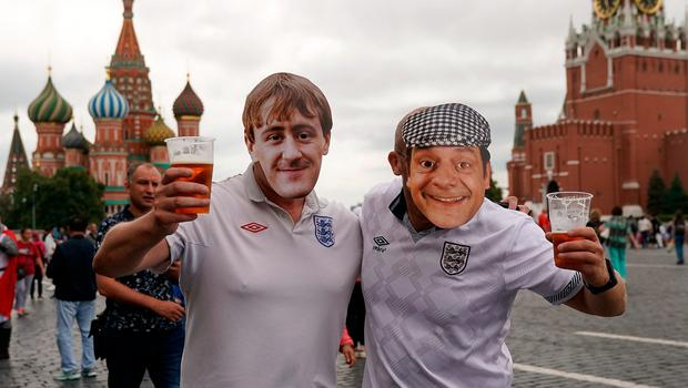 MOSCOW, RUSSIA - JULY 11:  England fans wearing Rodney and Dell Boy masks pose in Red Square ahead of tonight's World Cup semi-final game between England and Croatia on July 11, 2018 in Moscow, Russia.  (Photo by Christopher Furlong/Getty Images)