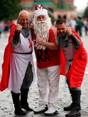 MOSCOW, RUSSIA - JULY 11:  England fans pose with a Russian fan in Red Square ahead of tonight's World Cup semi-final game between England and Croatia on July 11, 2018 in Moscow, Russia.  (Photo by Christopher Furlong/Getty Images)