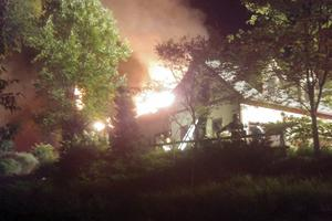 Rachael Ray's home on fire in Lake Luzerne, New York (Courtesy Kenneth Dickinson via AP)