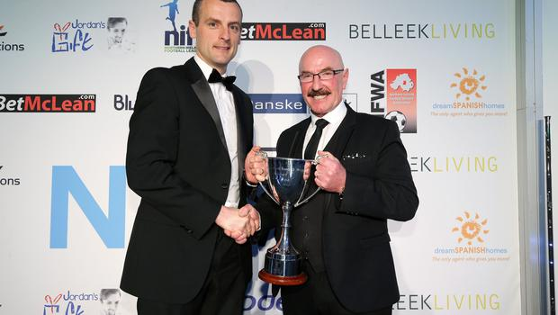Liam Beckett makes a presentation to Oran Kearney, Manager of the Year. Photo by Kelvin Boyes / Press Eye