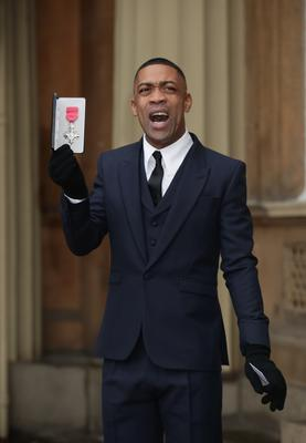 Wiley holding his MBE following an investiture ceremony at Buckingham Palace in 2018 (Yui Mok/PA).