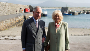 Britain's Prince Charles, Prince of Wales (L) and his wife Camilla, Duchess of Cornwall (R) visit the harbour in the village of Mullaghmore in Ireland on May 20, 2015 where the prince's great-uncle Lord Mountbatten was killed in an IRA explosion in 1979.