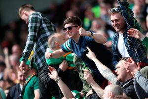 EDINBURGH, SCOTLAND - APRIL 02: Celtic fans celebrate during the Ladbrokes Premiership match between Hearts and Celtic at Tynecastle Stadium on April 2, 2017 in Edinburgh, Scotland. (Photo by Ian MacNicol/Getty Images)