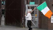 A man protests outside Antrim PSNI station last night after police were granted another 48 hours to question Gerry Adams