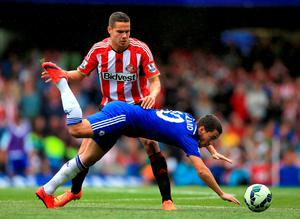 Chelsea's Eden Hazard (right) and Sunderland's Jack Rodwell in action during the Barclays Premier League match at Stamford Bridge, London. Nick Potts/PA Wire.