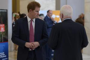 WASHINGTON, DC - MAY 09:  Prince Harry (L) tours a HALO Trust photo exhibit on landmines and unexploded ordinances, with Republican Senator from Arizona John McCain (R), on Capitol Hill on May 9, 2013 in Washington, DC. HRH will be undertaking engagements on behalf of charities with which the Prince is closely associated on behalf also of HM Government, with a central theme of supporting injured service personnel from the UK and US forces. (Photo by Michael Reynolds-Pool/Getty Images)