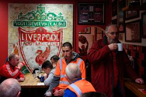 LIVERPOOL, ENGLAND - APRIL 01:  Liverpool fans enjoy some pre match food in a local cafe prior to the Premier League match between Liverpool and Everton at Anfield on April 1, 2017 in Liverpool, England.  (Photo by Gareth Copley/Getty Images)