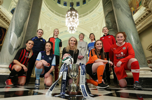Kick-off: Nicola McCleery, head of marketing at Danske Bank and Maura Muldoon, Chairperson of the Women's Premiership Committee, join players from the eight teams at the launch of the Danske Bank Women's Premiership last night