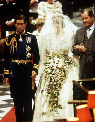 File photo dated 29/07/81 of Earl Spencer (R), accompanying his daughter Lady Diana at her wedding to the Prince of Wales, at St Paul's Cathedral, London. Diana, Princess of Wales's spare wedding dress, made in case of any mishaps on the big day, is now up for sale. The replica of the famous ivory silk gown was tried on by Lady Diana Spencer on the morning of her marriage to the Prince of Wales. It is expected to fetch more than ?50,000 when it goes under the hammer next month through Cooper Owen auctioneers.