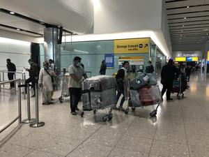 People come into the arrivals lounge in Terminal 2 at Heathrow (Steve Parsons/PA)