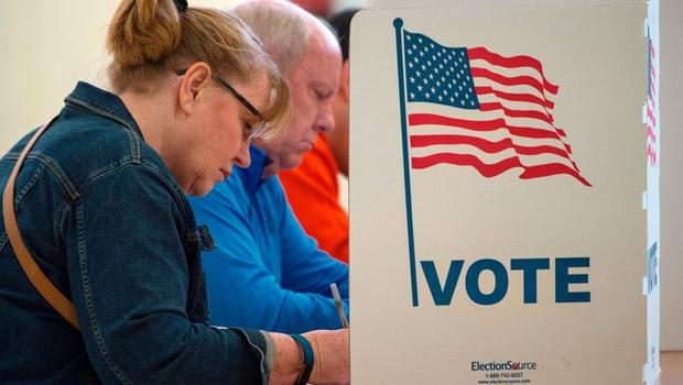 TOPSHOT - People cast their votes for US president November 8, 2016, at Centerville High School, in Centreville, Virginia. Polling stations opened Tuesday as the first ballots were cast in the long-awaited election pitting Hillary Clinton against Donald Trump. / AFP PHOTO / PAUL J. RICHARDSPAUL J. RICHARDS/AFP/Getty Images