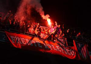 LISBON, PORTUGAL - MAY 24:  Atletico de Madrid  fans light a flare during the UEFA Champions League Final between Real Madrid and Atletico de Madrid at Estadio da Luz on May 24, 2014 in Lisbon, Portugal.  (Photo by Laurence Griffiths/Getty Images)