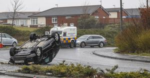 Police at the scene of a crash on the Monagh bypass West Belfast. The incident happened around 11pm. Two men were arrested in connection with a cash-in-transit robbery. Picture Colm O'Reilly / Sunday Life