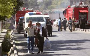 Roshan mobile company personal walk away near the site of an explosion in Kabul, Afghanistan, Wednesday, May 31, 2017. (Photo: Massoud Hossaini, AP Photos)