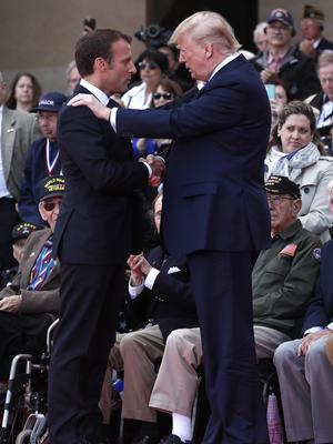 The two presidents share a moment at Colleville-sur-Mer (Ian Langsdon/Pool via AP)