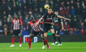 Liverpool's Jordan Henderson (right) in action against Southampton's Victor Wanyama during the Barclays Premier League match at St Mary's, Southampton. Chris Ison/PA Wire.