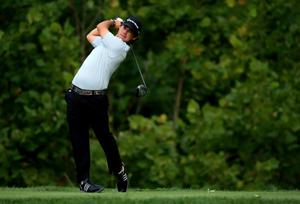 LOUISVILLE, KY - AUGUST 07:  Brian Harman of the United States hits his tee shot on the fourth hole during the first round of the 96th PGA Championship at Valhalla Golf Club on August 7, 2014 in Louisville, Kentucky.  (Photo by David Cannon/Getty Images)