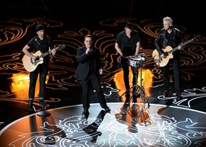 HOLLYWOOD, CA - MARCH 02:  (L-R) Musicians The Edge, Bono, Larry Mullen Jr., and Adam Clayton of U2 perform onstage during the Oscars at the Dolby Theatre on March 2, 2014 in Hollywood, California.  (Photo by Kevin Winter/Getty Images)