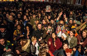 """Crowds gather outside the Ritzy cinema in south London to pay homage to British singer David Bowie following the announcement of Bowie's death on January 11, 2016. British music icon David Bowie died of cancer at the age of 69, drawing an outpouring of tributes for the innovative star famed for groundbreaking hits like """"Ziggy Stardust"""" and his theatrical shape-shifting style.  AFP PHOTO / CHRIS RATCLIFFECHRIS RATCLIFFE/AFP/Getty Images"""