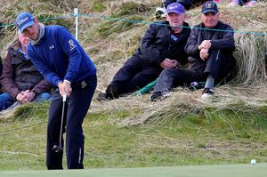 Austrian golfer Bernd Wiesberger watches his putt shot on the 5th green on the second day of the Irish Open at the Royal County Down Golf Club in Newcastle in Northern Ireland on May 29, 2015.      AFP PHOTO / PAUL FAITHPAUL FAITH/AFP/Getty Images
