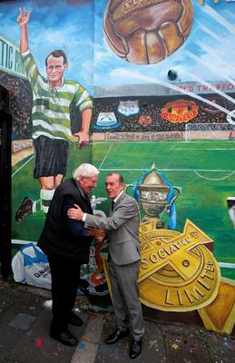 Michael O'Connell speaking to Belfast Lord Mayor Arder Carson as a new mural is unveiled in Belfast to mark the life of his grandfather, footballer Patrick O'Connell, whose career saw him play for Belfast Celtic and Manchester United and manage FC Barcelona. Photo: Niall Carson/PA