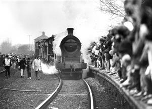 The steam engine on route from Witham Street to Cultra passes through Holywood.  14/2/1993