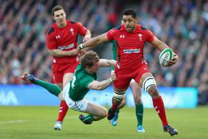 DUBLIN, IRELAND - FEBRUARY 08: Taulupe Faletau (R) of Wales is challenged by Andrew Trimble (L) of Ireland during the RBS Six Nations match between Ireland and Wales at the Aviva Stadium on February 8, 2014 in Dublin, Ireland.  (Photo by Michael Steele/Getty Images)
