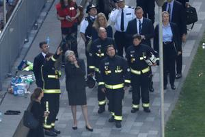 British Prime Minister Theresa May (C) speaks with Dany Cotton (L), London Fire Brigade commissioner as she visits the remains of Grenfell Tower, a residential tower block in west London which was gutted by fire on June 14, 2017. Firefighters searched for bodies today in a London tower block gutted by a blaze that has already left 12 dead, as questions grew over whether a recent refurbishment contributed to the fire. / AFP PHOTO / Tolga AKMENTOLGA AKMEN/AFP/Getty Images