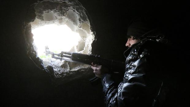 A rebel fighter holds a position in al-Mayasat, a rebel-controlled area near the industrial zone of the northern Syrian city of Aleppo on February 4, 2015.