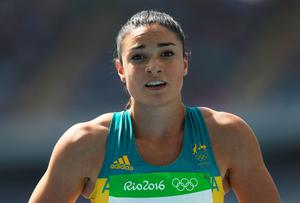 RIO DE JANEIRO, BRAZIL - AUGUST 16:  Michelle Jenneke of Australia reacts after competing in the Women's 100m Hurdles Round 1 - Heat 2 on Day 11 of the Rio 2016 Olympic Games at the Olympic Stadium on August 16, 2016 in Rio de Janeiro, Brazil.  (Photo by Patrick Smith/Getty Images)
